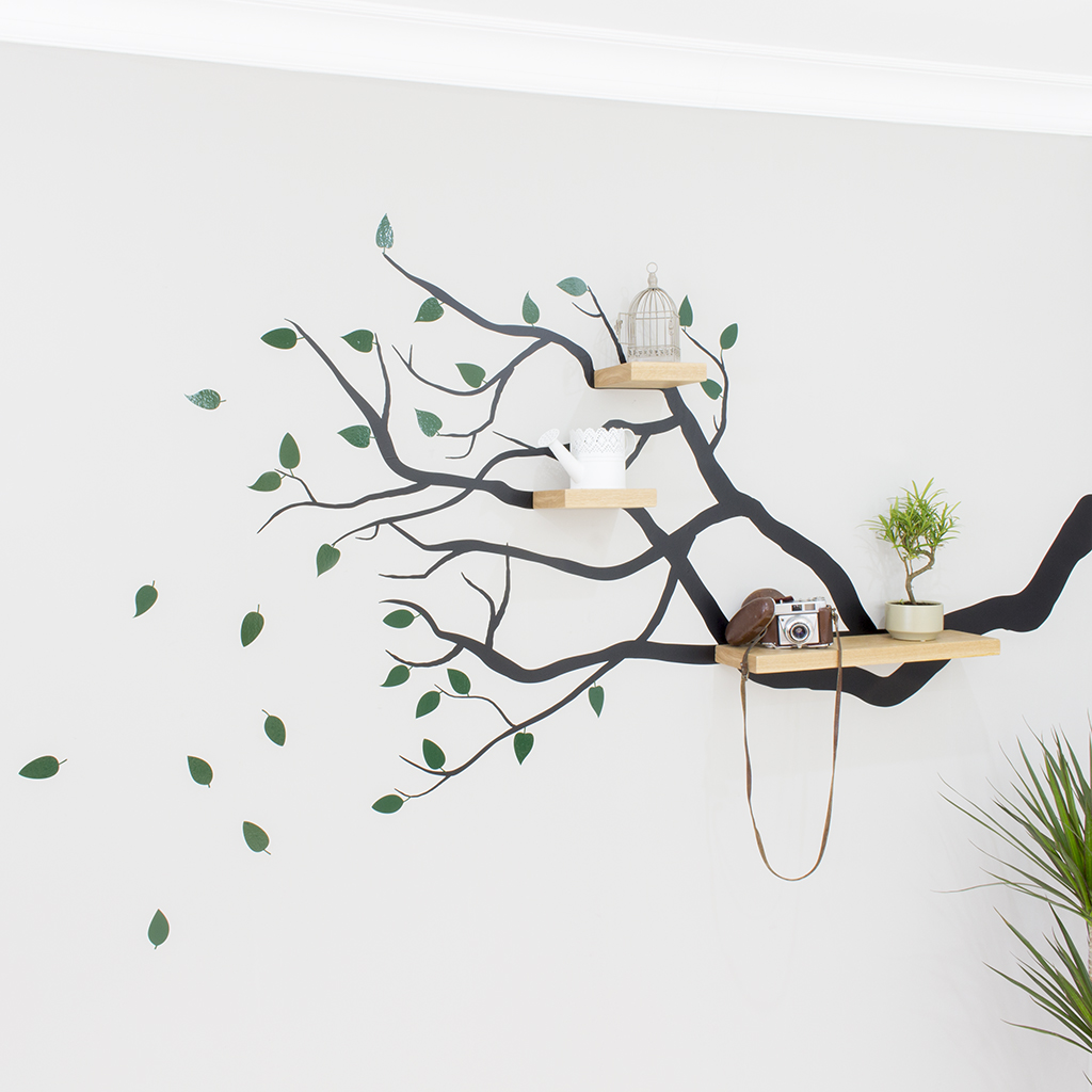 tree branch wall decal with floating shelves bespoak interiors